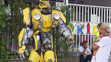Photo of Father dresses as Transformer on son's first day back at school