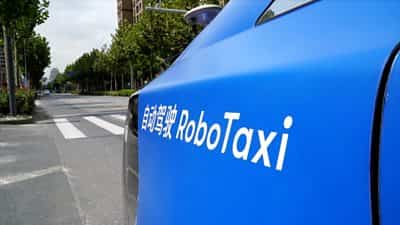 china's-robot-taxis:-would-you-ride-in-one?