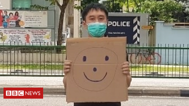 Photo of Singapore: Jolovan Wham charged for holding up a smiley face sign