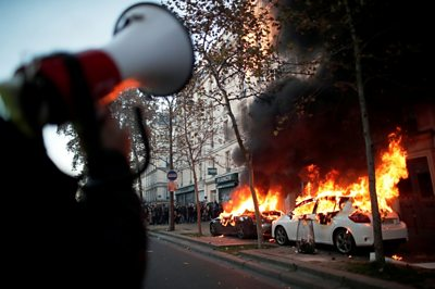 paris:-tear-gas-and-fires-at-protest-against-police-violence