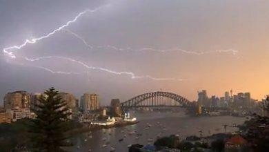 Photo of Sydney storm sets bell tower ablaze and cuts power to thousands