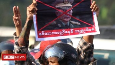 Photo of Myanmar coup leader defends action amid mass protests