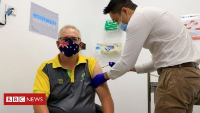 Photo of Australian PM is vaccinated as rollout begins