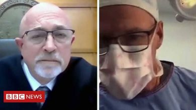 Photo of Doctor joins Zoom court hearing while operating on patient