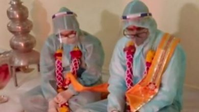 Photo of Covid in India: Couple marry in PPE clothing