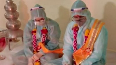 covid-in-india:-couple-marry-in-ppe-clothing