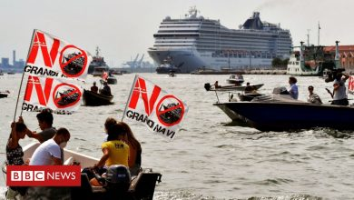Photo of Venice residents in environmental protest against first post-Covid cruise ship.