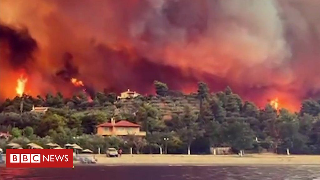 greece-wildfires-force-people-to-flee-island-by-boat