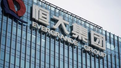 Photo of China real estate shares, bonds hit by Evergrande concerns