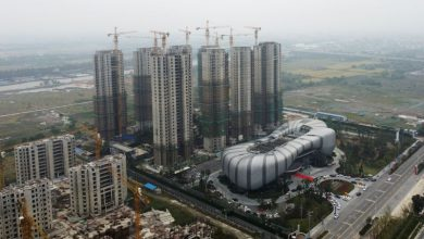 Photo of China's debt-ridden Evergrande resumes work on more than 10 property projects